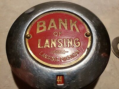 Vintage mechanical coin operation bank. Bank of Lansing . Michigan dimes w/ key