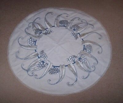 Vintage round table cloth with embroidered blue and white thread and lace edge