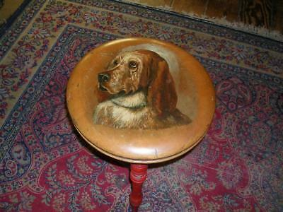 Antique stool with painted dogs head.