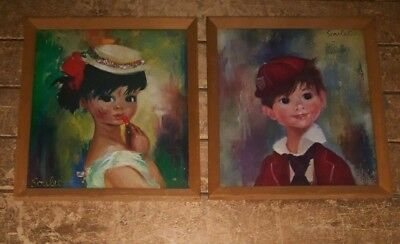A pair of vintage Soulet boy & girl art prints in wooden 8 x 9 inch frames. 4B.