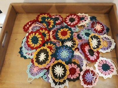 Box of hand made crochet motifs - multicoloured. Ideal for cushions or blanket.