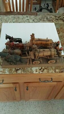2 ANRI Handcarved Wine Wagons on  Platforms