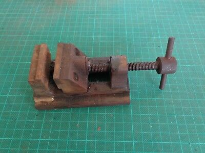 Vintage vice or clamp, small size, flat on bench, has been mended