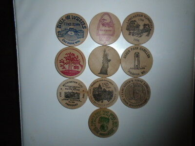 """Lot #2 containing 10 different 2"""" wooden dollars all in great condition"""