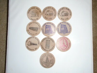 """Lot #7 containing 10 different 2"""" wooden dollars all in great condition"""