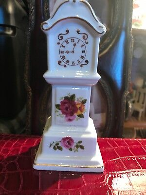 This is a vintage Miniature grandfather clock fine bone China