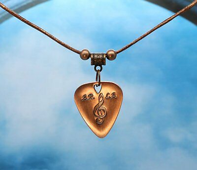 Bright Copper Metal Guitar Pick With Treble Clef On Metallic Leather Necklace