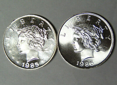 Lot of 2: 1985 1986 Peace Dollar Style 1 oz .999 Fine Silver Rounds (92118)