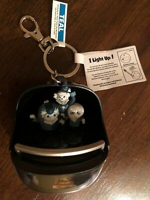 Disney World Haunted Mansion Hitchhiking Ghosts Light Up Keychain New with Tags