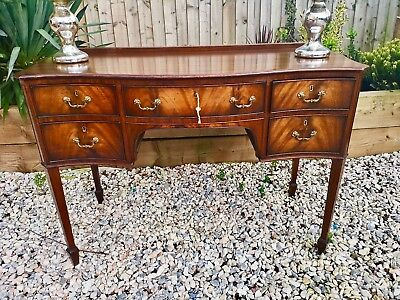 Antique lowboy, desk Made by the world renowned Denby and Spinks of Leeds Englan