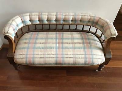 antique settee with curved back
