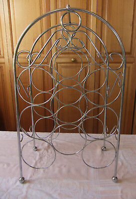 Modern chrome coloured metal wine rack, bottle stand, holds 9 bottles