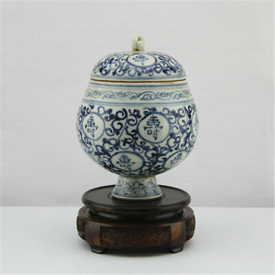 The ancient Chinese hand-painted blue and white porcelain tea pot.