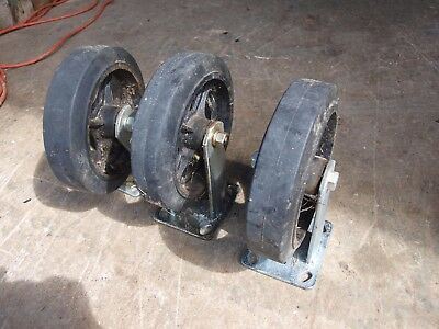 "Set Of 3 Used 8"" Wheel Industrial Casters - 1 Swiveling, 2 Fixed"