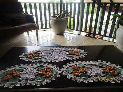 set of three beautiful crocheted doilies white with orange flowers & greenleaves