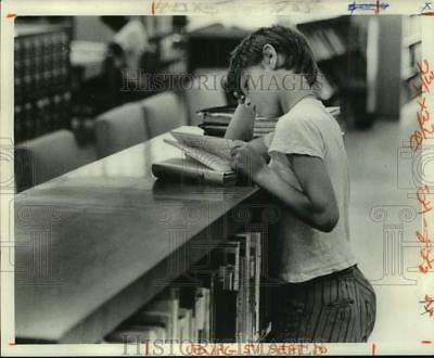 1974 Press Photo A young boy reading a book in New Orleans Public Library
