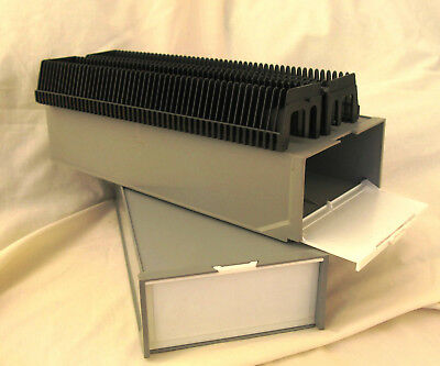 Slide storage boxes, each with two universal 50-slide magazines.