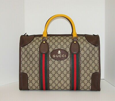 d99153170806 Gucci Soft GG Supreme Duffle Bag With Web And Leather Tag With Skull Detail
