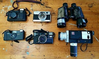 Untested Vintage 35 mm cameras and binocular.
