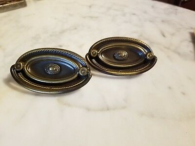 Two Metal Oval Ornate Drawer Pulls