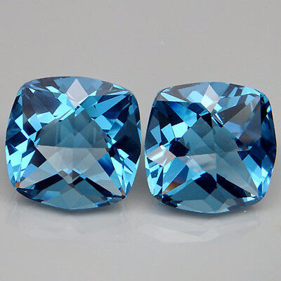 28.4ct. Winsome Pair!!! Blue Topaz Cushion With Fancy Table
