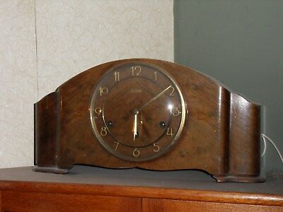 Junghans mantle clock with full Westminster chime and walnut case