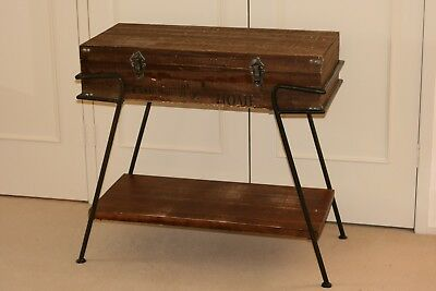 Small table with full width hinged lid.