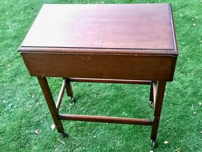 Mahogany small drop leaf table on casters good condition ideal for small area