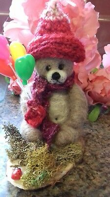 5 inch Little brown bear dressed for the cold carrying his coloured balloons
