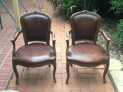 Reproduction antique chairs ,leather and wood .