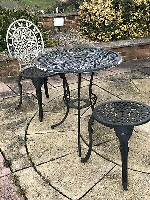 Vintage heavy French Bistro Table And with one chair and a stool Original cast