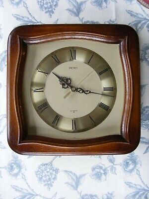 Seiko vintage wall clock, with dark wood surround and Roman numeral dial