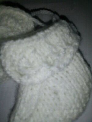 Knitted babies booties to fit new born