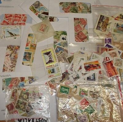 50 packets of stamps, mostly Australian but some world. bulk lot.