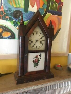 Arts and Crafts Clock. Mahogany case Needs cleaning and repair.