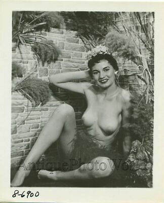 Smiling nude woman with flower in hair vintage photo