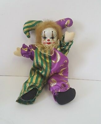 VINTAGE PORCELAIN CLOWN Doll ,, In Yellow/ Black Trenchcoat   Good