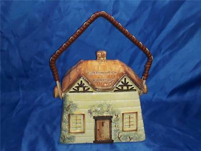 Keele St Pottery Biscuit barrel in shape of thatched Cottage Cottage wear