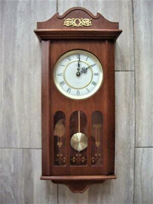 MAHOGANY WESTMINSTER QUARTZ WALL CLOCK - good working order.
