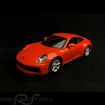 Porsche 911 type 992 Carrera 4S Coupe orange fusion à friction 1/43 Maisto WAP02