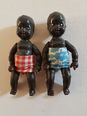 Pair of Vintage English black Plastic dolls with rubber arms and legs marked