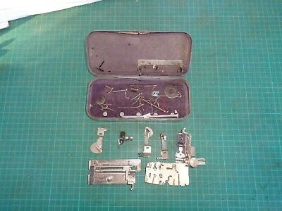 Vintage SINGER sewing machine attachments in original tin box