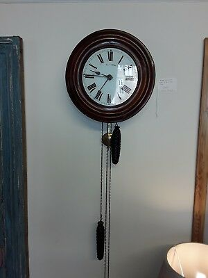 antique pendulum wall clock, rare postmans alarm clock. Weight driven movement
