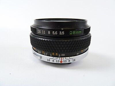 Olympus OM Zuiko Auto-W 28mm F3.5 Wide Angle Lens with caps & Case in EC