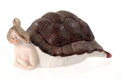 Mildly erotic porcelain fairing: woman in turtle shell with teddy bear [F124]