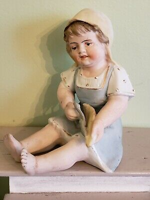 Antique German All Bisque Porcelain Piano Baby Figurine Girl Husking Corn