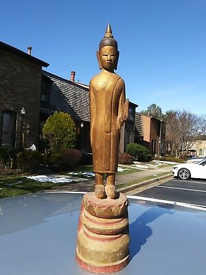 Old Asian Thailand carved wood Standing Temple Buddha statue with hidden scroll