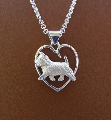 Small Sterling Silver Norwich Terrier Moving Study On A Heart Pendant