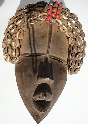 African Dan Tribe Liberia Hand Carving Wood Mask with Cowrie shells. Antique art
