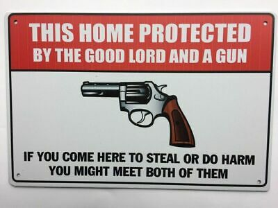 No trespassing. Protected By The Lord  and This Gun.Tin Sign.